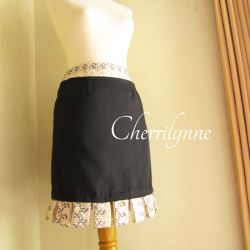 Black Skirt with Loops Detail at The Hem